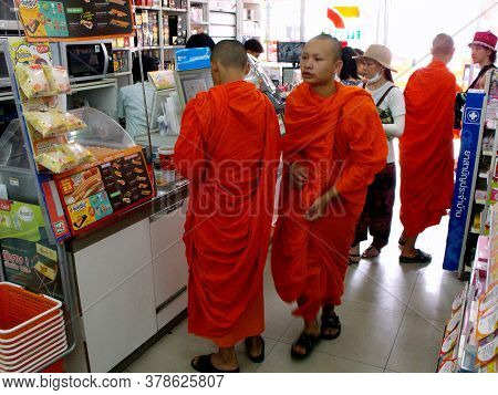 Chiang Mai, Thailand, April 25, 2016: Buddhist Monks Buying In A Store In Chiang Mai, Thailand.
