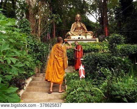 Chiang Mai, Thailand, May 25, 2017: Buddhist Monks Photographing Themselves Next To The Statue Of A