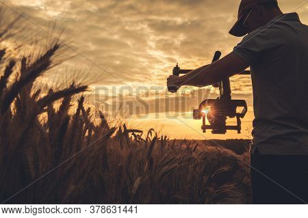 Cinema And Stock Footage Production. Caucasian Video Camera Operator In His 40s With Gimbal Stabiliz