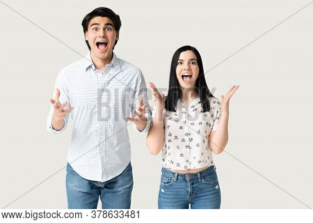 Astonished Hispanic Boyfriend And Girlfriend With Mouth Wide Open