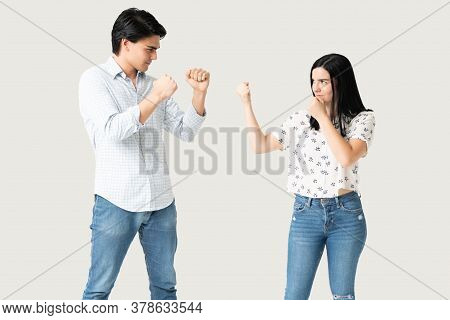 Aggressive Hispanic Boyfriend And Girlfriend Ready To Fight Against Each Other