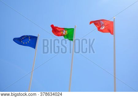 Flag Of Cascais Town And Portugal . Three Waving Flags . The Flag Of The European Union