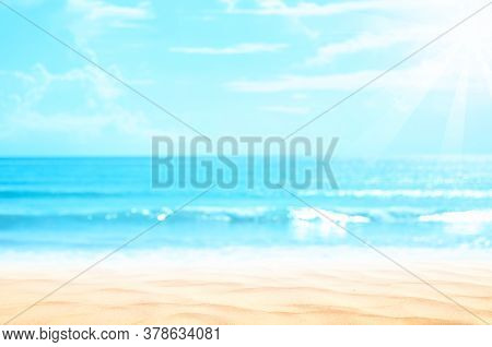 Copy Space Blur Tropical Beach With Bokeh Sun Light Wave On Blue Sky And White Cloud Abstract Backgr