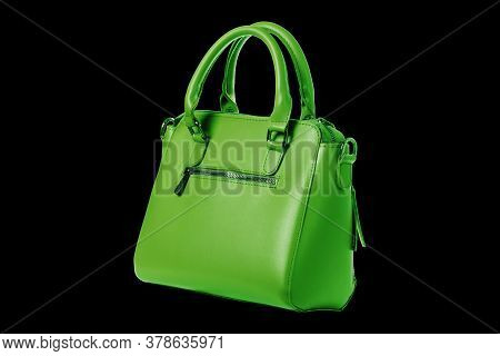 Green Leather Women's Bag With Top Handle Isolated On Black Background. Front View Of A Lady Shoppin