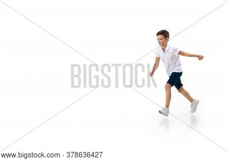 Happy Kids, Little And Emotional Caucasian Boy Jumping And Running Isolated On White Background. Loo