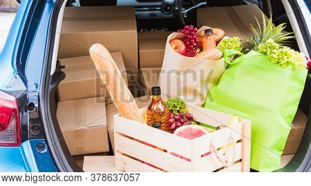 Grocery Service Giving Fresh Vegetables And Fruits And Food In Green Cloth Bag And Wooden Basket On