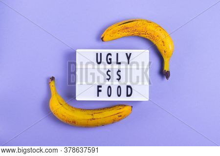 Inscription Ugly Food On A Purple Background With Ugly Bananas With Defects