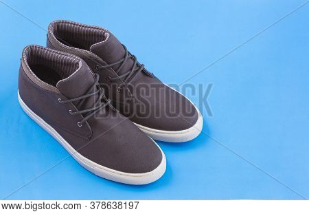 Shoe With White Sole For Man - Blue Background. Top View