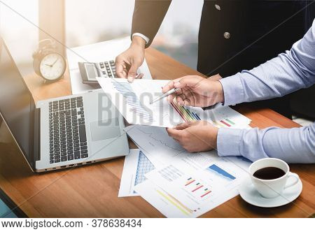 Business Team Analyzing Income Charts And Graphs,financial Analysis And Business Performance