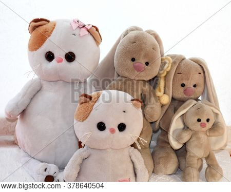 Soft Toys Kittens And Bunnies On A Light Background.