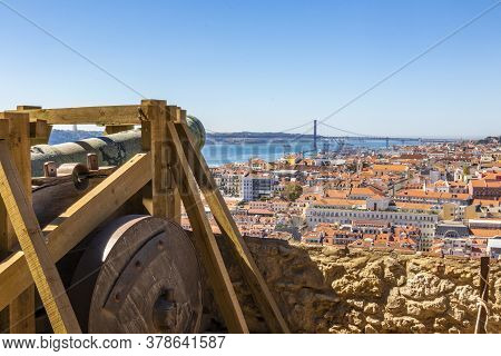 Aerial View On Lisbon With Hostoric Cannon From Castelo De Sao Jorge In Portugal