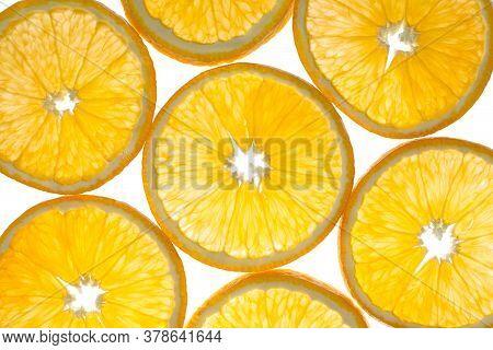 Backlit Orange Slices On A White Background.