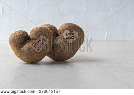Ugly Heart Shaped Kiwi Fruits With Labels On Grey Table, Copy Space. Organic Misshapen Produce. Tren
