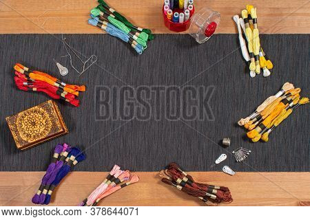 Various Colored Mouline Threads, Yarns, Threads Lie On The Table With Accessories For Needlework And