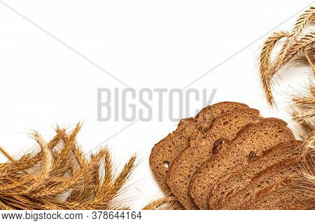 Delicious Bread. Fresh Loaf Of Rustic Traditional Bread With Wheat Grain Ear Or Spike Plant Isolated