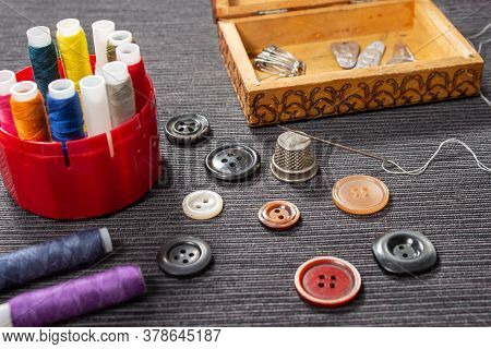 Various Colored Buttons For Clothes Lie On The Table. Sewing Accessories Are Lying Next To You. Sewi