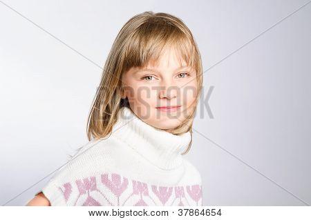 Winter Portrait Of A Beautiful Preteen Girl 8-10 Years Old. Studio Photoshoot