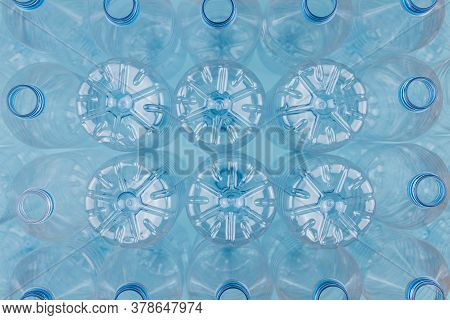Horizontal Color Image With An Overhead View Of An Empty Clear Plastic Bottles Upside Down Stacked O