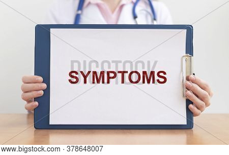 Text Word Symptoms In Doctor Hand, Symptoms Concept