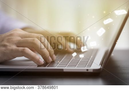Businessman Using Laptop Computer To Send Electronic Mail Or E-mail. Business Technology Transformat