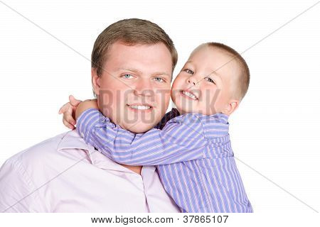 Portrait Of Cute Little  Boy 3-4 Years Old Embracing Her Dad Isolated Over White