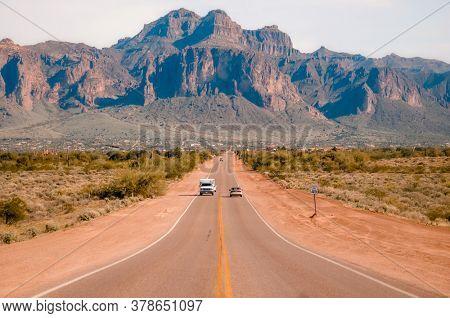 Arizona desert road leading to Superstition Mountain, just outside Phoenix, Arizona, USA