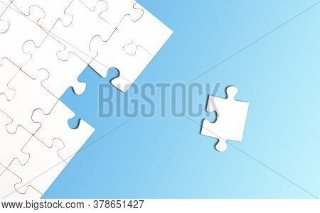 Top View Of Incomplete Jigsaw Puzzle With One Piece Left On Bright Blue Background, Completing A Tas