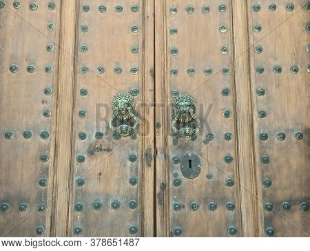 Old Fashioned Doorbell On Wooden Door In Old Town Of Priego De Córdoba Andalusia Spain