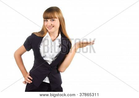 Cute Student Girl With Presenting Gesture Isolated Over White