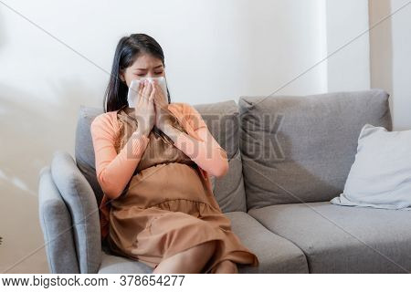 Young Asian Pregnant Woman Have Suffering From Flu And Sneeze, Runny Nose, Stuffy Nose And Then Her