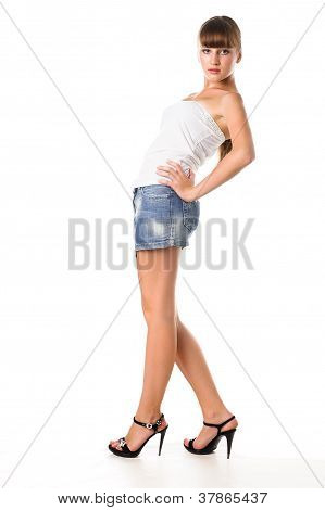 Beautiful Stylish Teen Girl Standing Up Isolated Over A White Background
