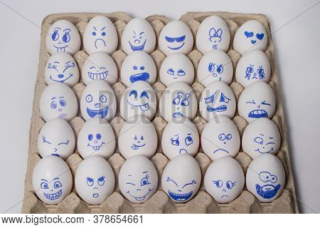 Funny Chicken Eggs. Smiley Eggs With Faces, Funny Faces. Eggs With Different Emotions: Laughter, Smi