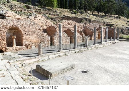 The Ruins In Delphi, An Archaeological Site In Greece At The Mount Parnassus. Delphi Is Famous By Th
