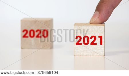 Happy New Year 2021 Wood Cube Blocks And Leaving The Year 2020 Represented By 0 Behind To Be Forgott