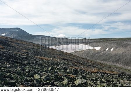The Concept Of Outdoor Activities In The Mountains. Minimalist Mountain Landscape With A Snowy Field