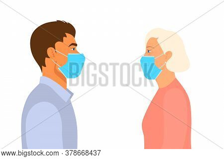 Young Man And Old Woman Look At Each Other In The Respiratory Medical Masks In The Distance. Quarant