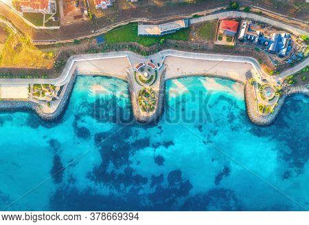 Aerial View Of Beautiful Sandy Beach, Blue Sea, Restaurants On The Promenade, Pool, Umbrellas, Swimm