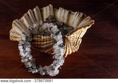 Necklace Made Of Quartz With Tourmaline In The Seashell