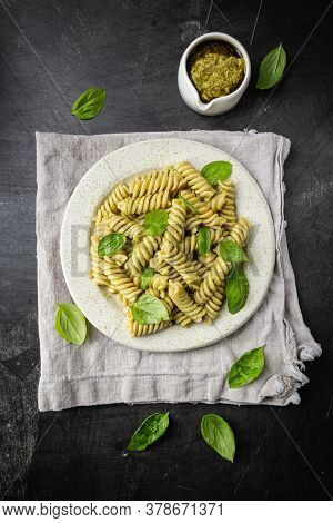 Italian Fussili Pasta With Basil Pesto And Fresh Basil On Black Background. Top View.