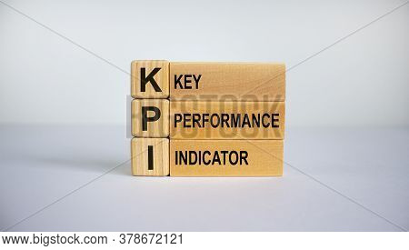 Concept Words 'kpi, Key Performance Indicator' On Cubes On A Beautiful White Background. Business Co