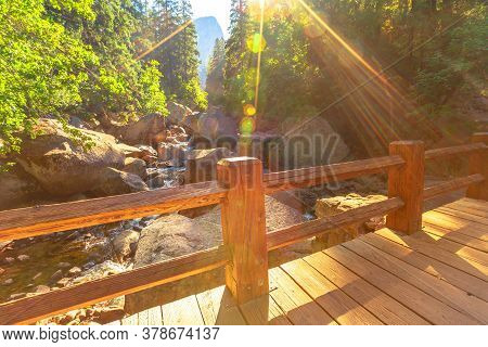 Vernal Falls Bridge Of Merced River With Rainbow On John Muir Trail In Yosemite National Park. Summe