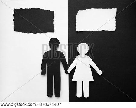 Symbol Of A Person And Family Cut Out Of Black And White Paper. Happy Interracial Family. Space For