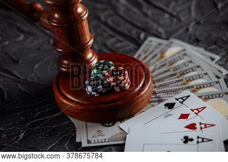 Concept Of Legal Regulation Of Gambling, Justice Gavel And Dice On The Background Of An Old Grey Tab