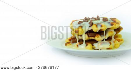 Traditional Waffles With White Plate And White Plate. Covered With White Sweet Cream And Sprinkled W