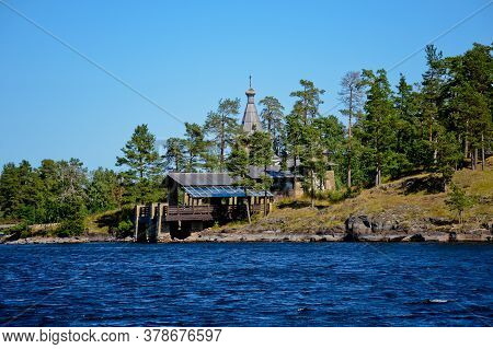 A Wooden Chapel In Honor Of All The Valaam Saints. Beautiful Nature Of The Valaam Archipelago On A C