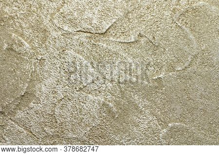 Golden Messy Wall Stucco Texture. Closeup Decorative Plaster Paint.
