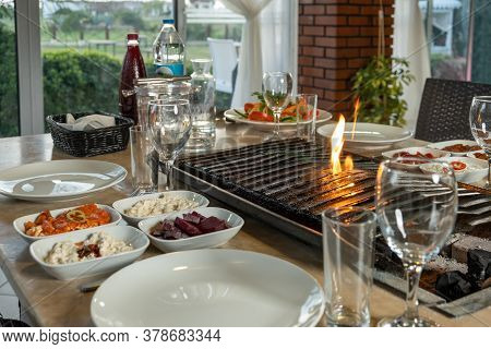 Different Types Of Meat Grilled On Barbecue On The Table, Served With Special Turkish Appetizers And