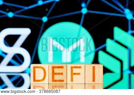 Defi Concept. Wooden Blocks With The Defi Inscription On The Background Of The Synthetix, Maker, Com
