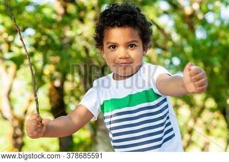 Close Up Of A Happy African Boy In Nature. Great Copy Space.