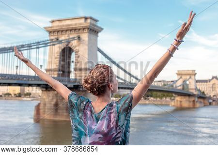 Thankful Redhead Young Woman Arms Raised At Budapest, Hungary